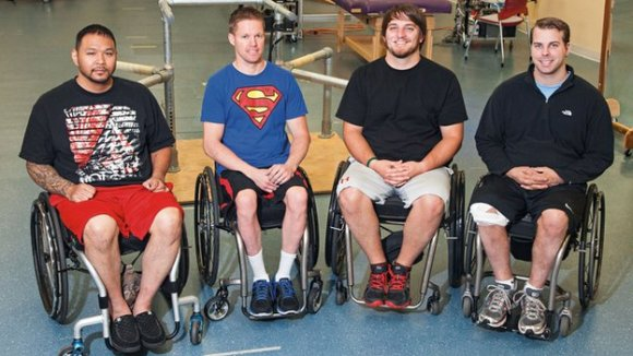 (Andrew Meas, Dustin Shillcox, Kent Stephenson and Rob Summers were treated at the University of Louisville's Kentucky Spinal Cord Injury Research Center.  Image Credit: BBC)