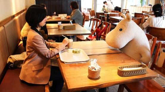 (Patron with a Moomin Companion,  Image Credit: CNN)
