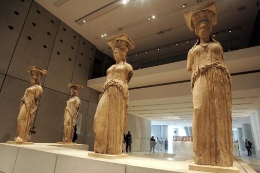 (The Restored Caryatids on Display at The Acropolis Museum. Image Credit: elladatora.org)
