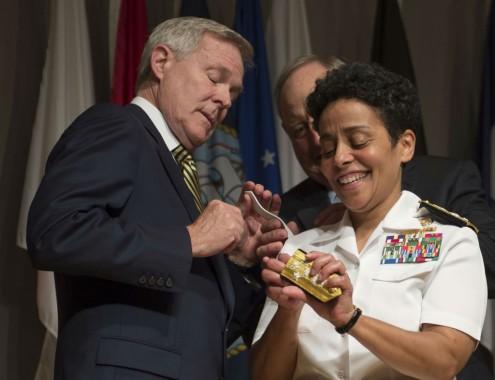(Admiral Howard receives her promotion. Image Credit: U.S. Navy)