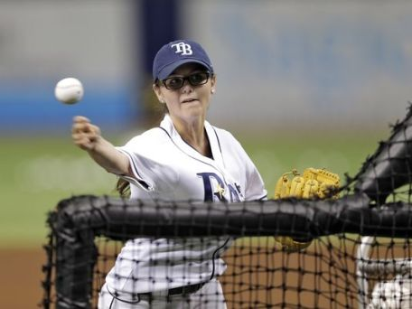 (Chelsea Baker pitches batting practice to the Rays. Image Credit: Associated Press)